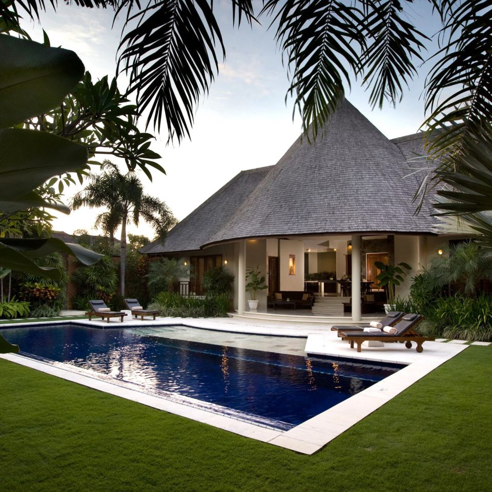 Hip Lounge Luxury Modern Pool tree grass swimming pool property house Resort plant backyard Villa home green mansion arecales Garden Courtyard hacienda palm landscape lighting Jungle