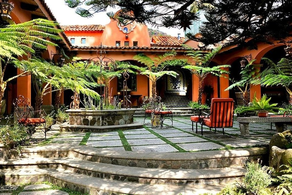 Courtyard Historic tree Resort property hacienda mansion home Jungle eco hotel Villa temple swimming pool plant Garden