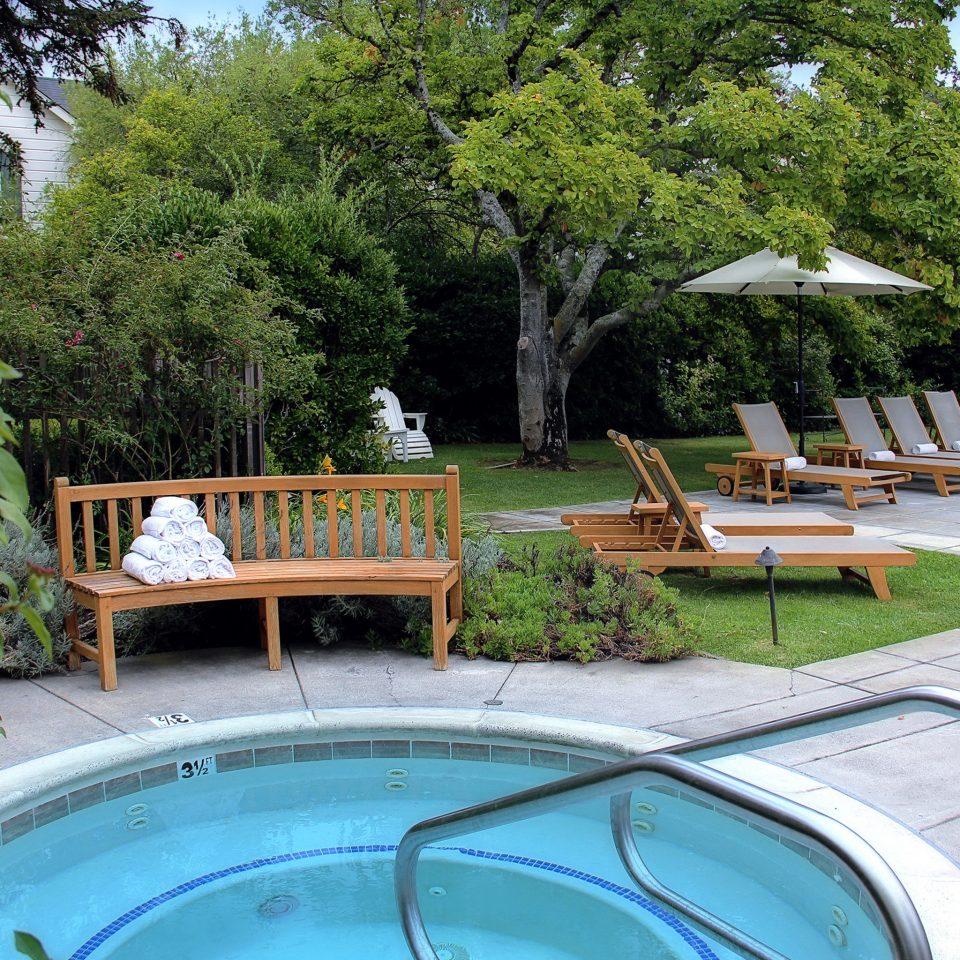 Hot tub/Jacuzzi Lounge Pool tree swimming pool property backyard park Resort Villa Garden landscape architect yard Courtyard outdoor structure bathtub