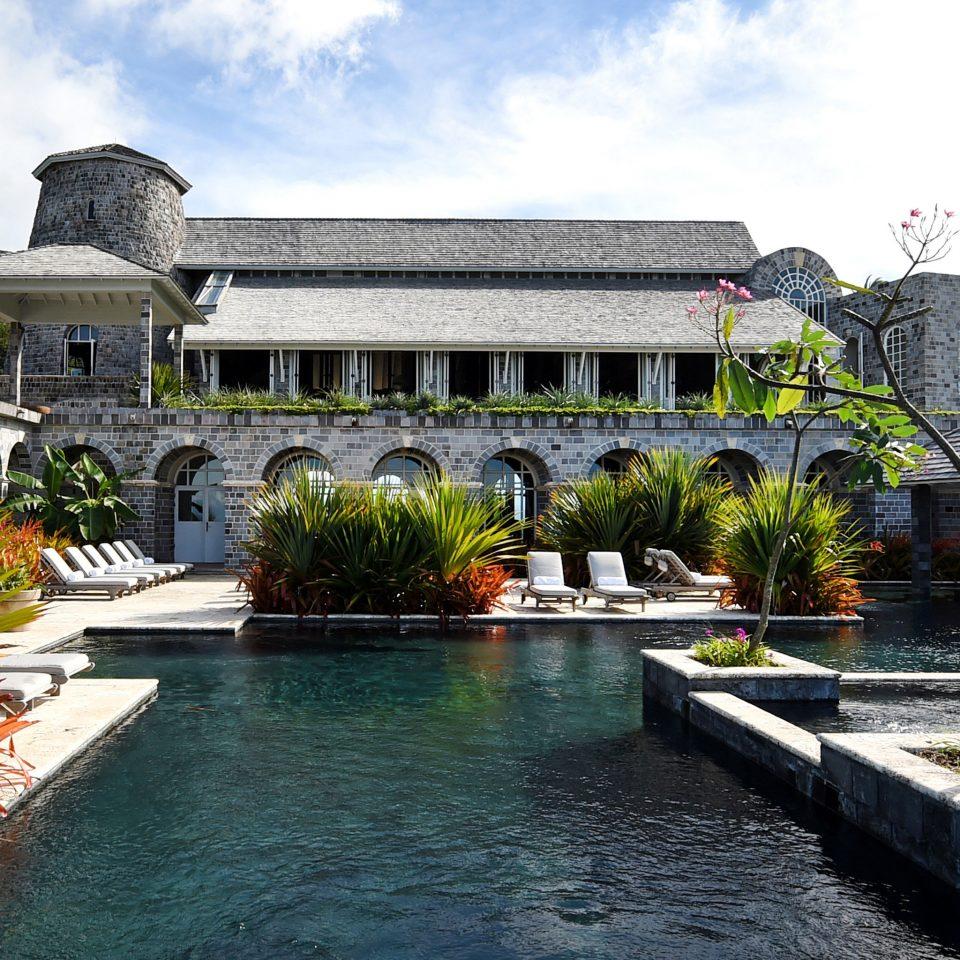Hotels Trip Ideas sky property building swimming pool reflecting pool Resort Courtyard home palace Garden backyard mansion Villa condominium stone