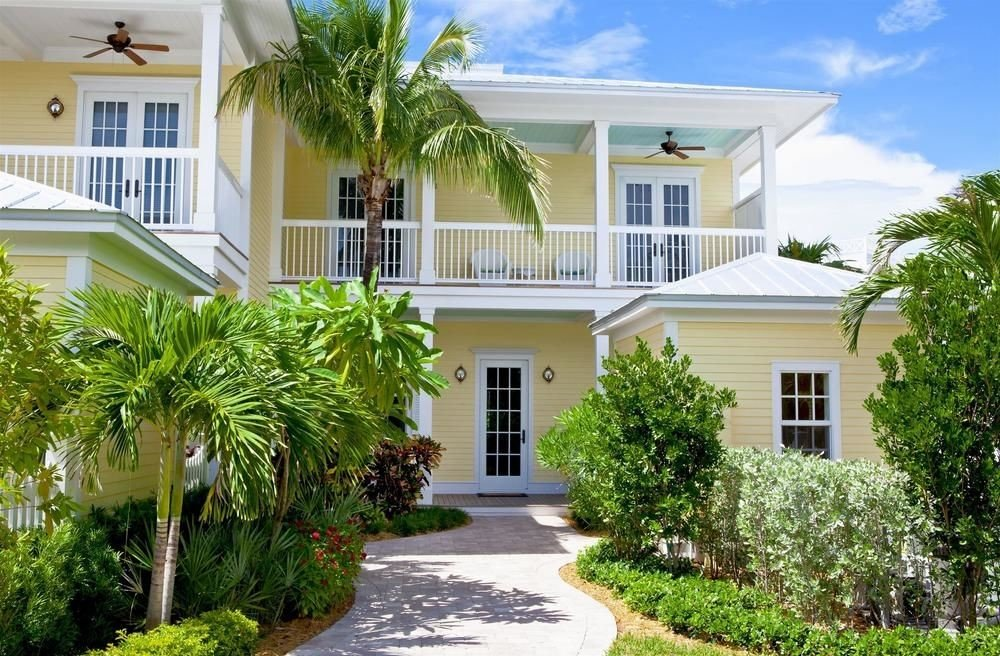 Hotels tree building house property home condominium residential area Villa plant Resort cottage mansion residential Courtyard bushes Garden