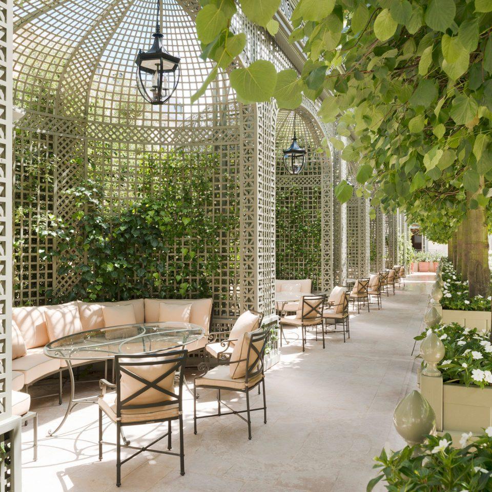 Hotels Romance Trip Ideas chair property Courtyard Garden backyard orangery outdoor structure cottage yard stone