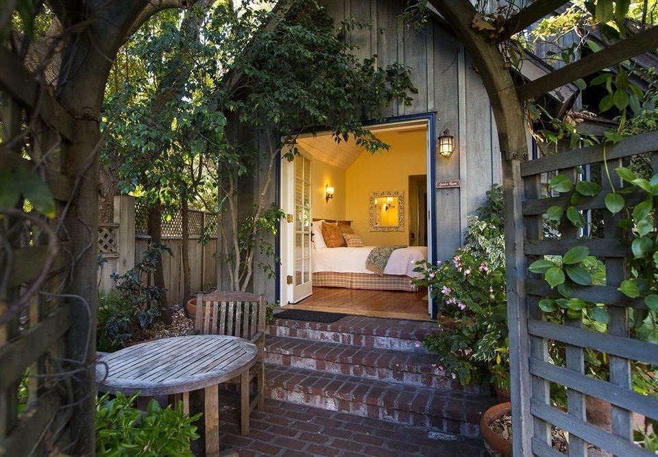 tree house Courtyard home cottage backyard yard Garden flower Resort outdoor structure Village Jungle hacienda porch