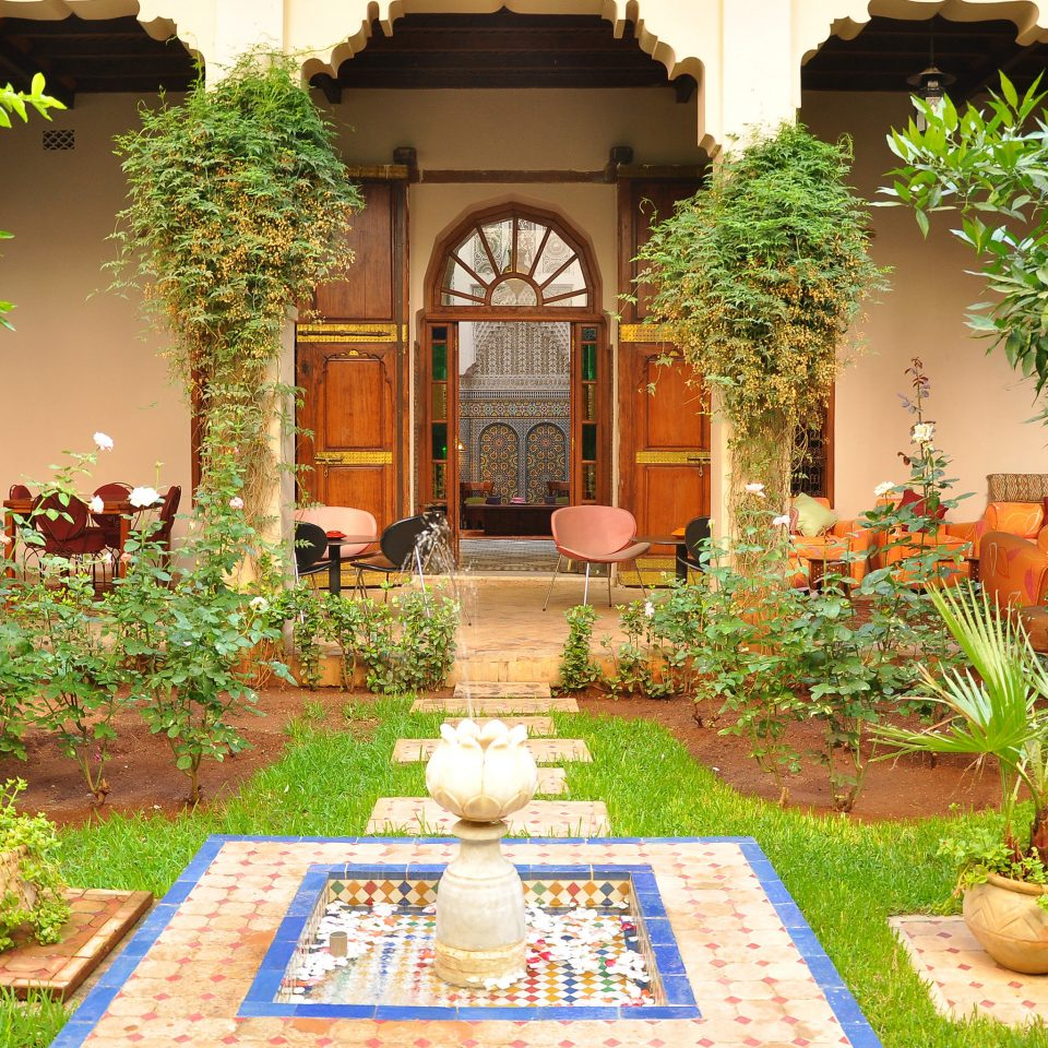 Garden Lounge Luxury Outdoors grass tree Courtyard home yard backyard hacienda mansion Resort flower lawn Villa