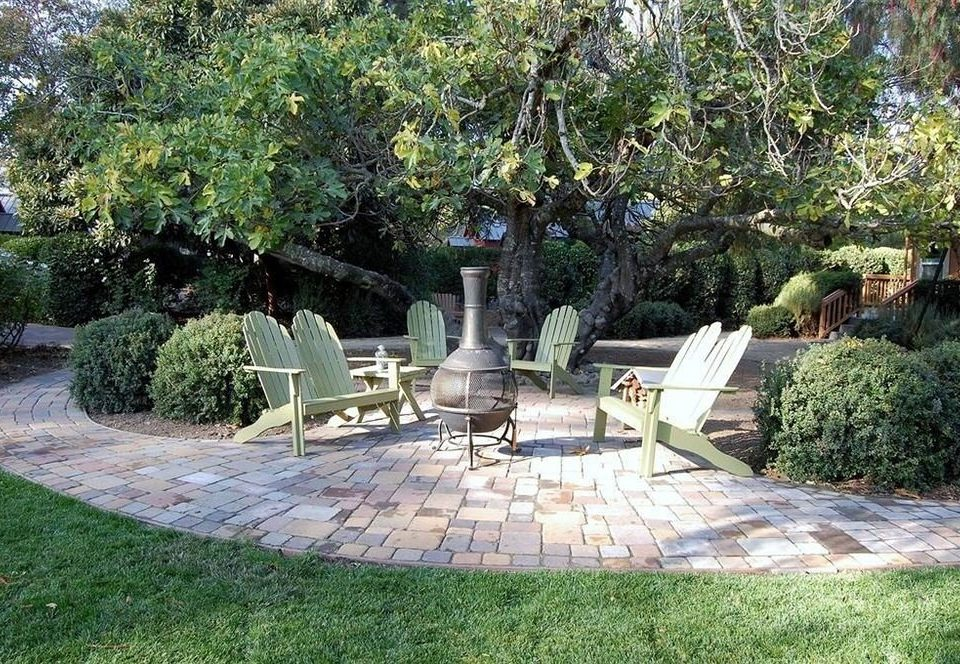tree grass ground property plant Garden yard backyard park lawn Courtyard landscape landscape architect outdoor structure landscaping Patio porch set