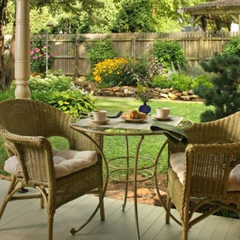 chair property backyard yard Courtyard Patio outdoor structure porch Garden lawn dining table