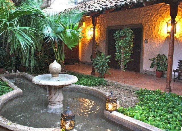 property plant backyard Courtyard Villa hacienda swimming pool yard landscape lighting Resort outdoor structure Garden Patio mansion landscaping stone