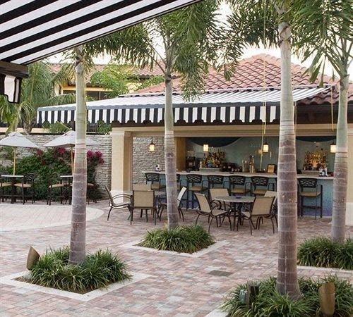 tree ground property building Resort home plaza condominium pergola Courtyard outdoor structure hacienda Garden restaurant Villa Patio plant