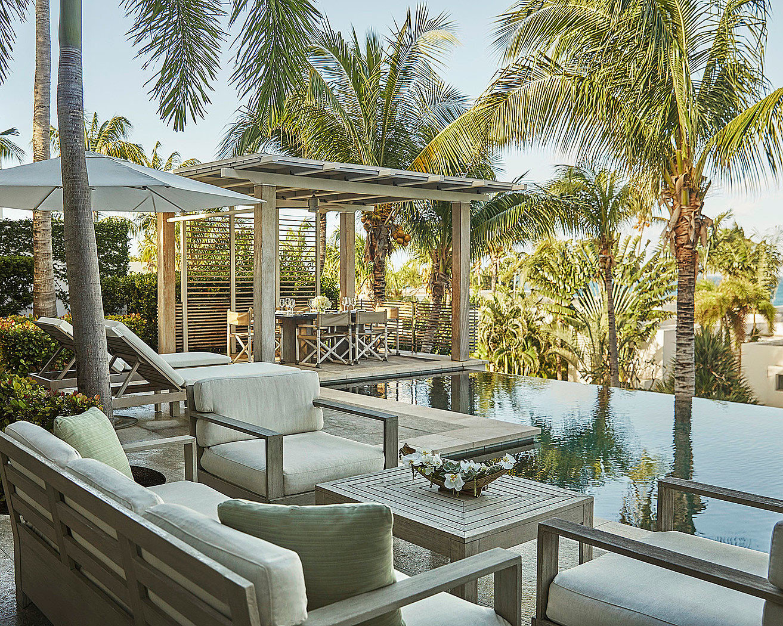 tree sky building property chair Resort porch Villa home outdoor structure Courtyard condominium backyard cottage Patio Garden