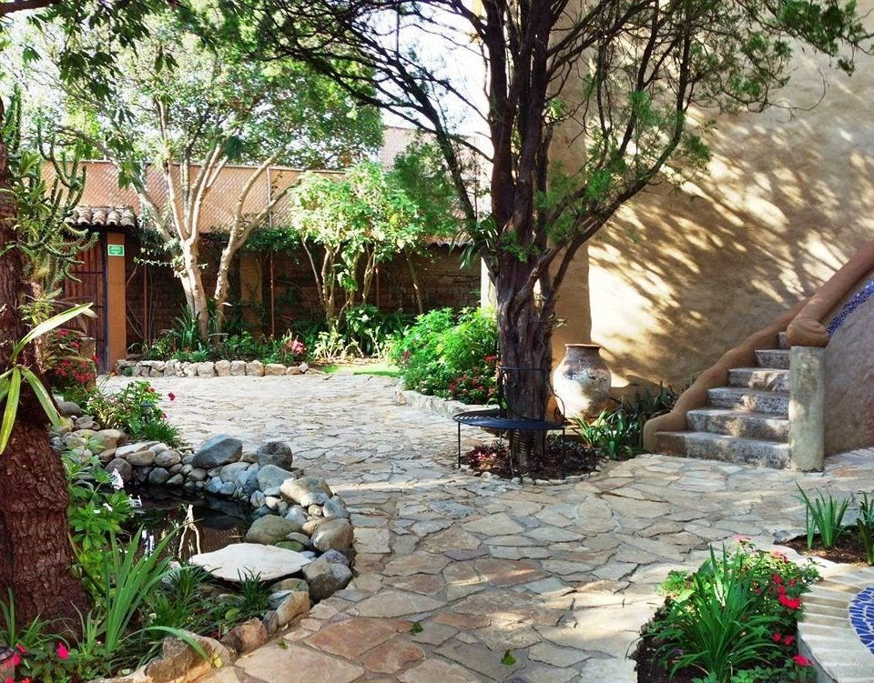 tree ground building property backyard yard walkway Courtyard stone home Garden landscape cottage outdoor structure plant Resort Patio landscaping landscape architect Villa