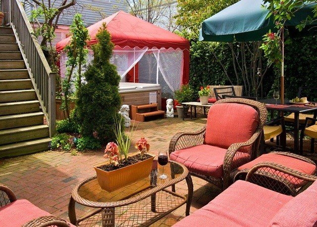 tree chair property backyard Resort cottage outdoor structure Villa Patio hacienda porch Courtyard yard set Garden