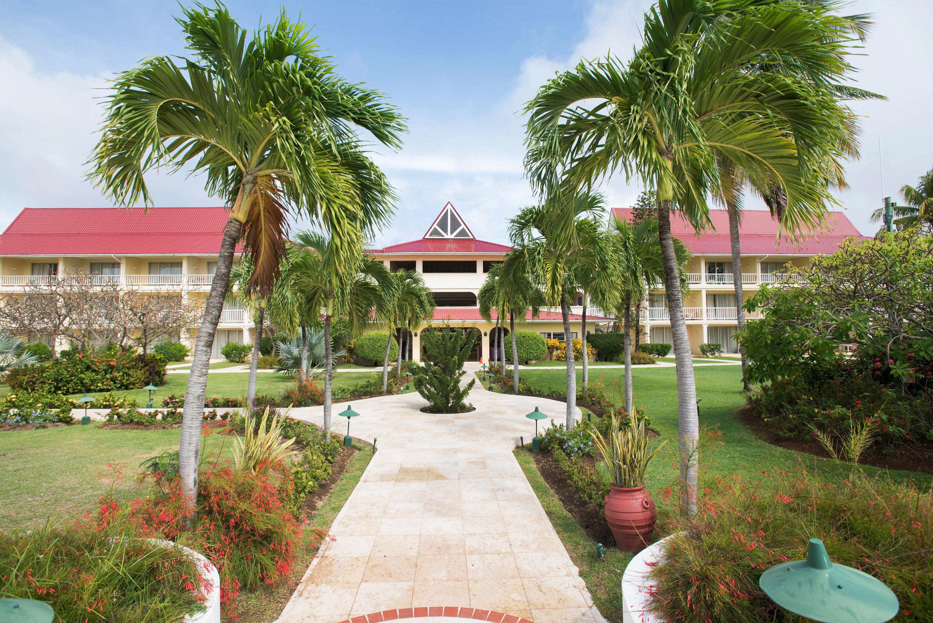 tree grass Resort lawn Garden walkway arecales house condominium plaza Courtyard hacienda palace botanical garden plant palm set shade