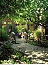 Garden Resort tree property plant home yard backyard Courtyard cottage lawn landscape outdoor structure landscape architect landscaping stone