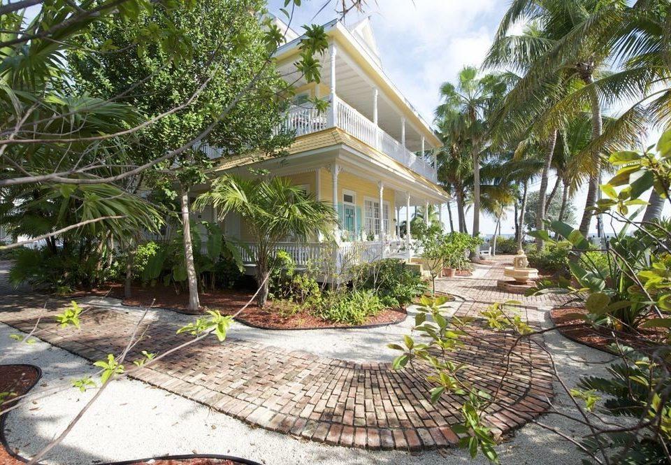 tree ground property Resort walkway Courtyard backyard home yard Garden Villa condominium landscaping plant stone