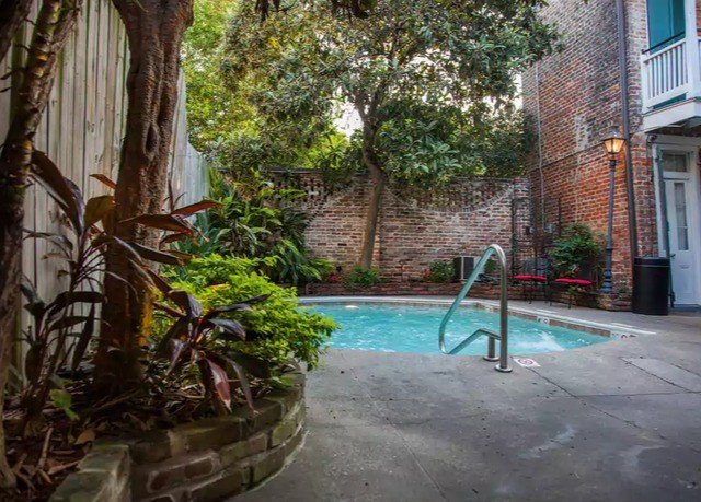 tree property Courtyard backyard home swimming pool mansion hacienda Villa Resort yard condominium Garden