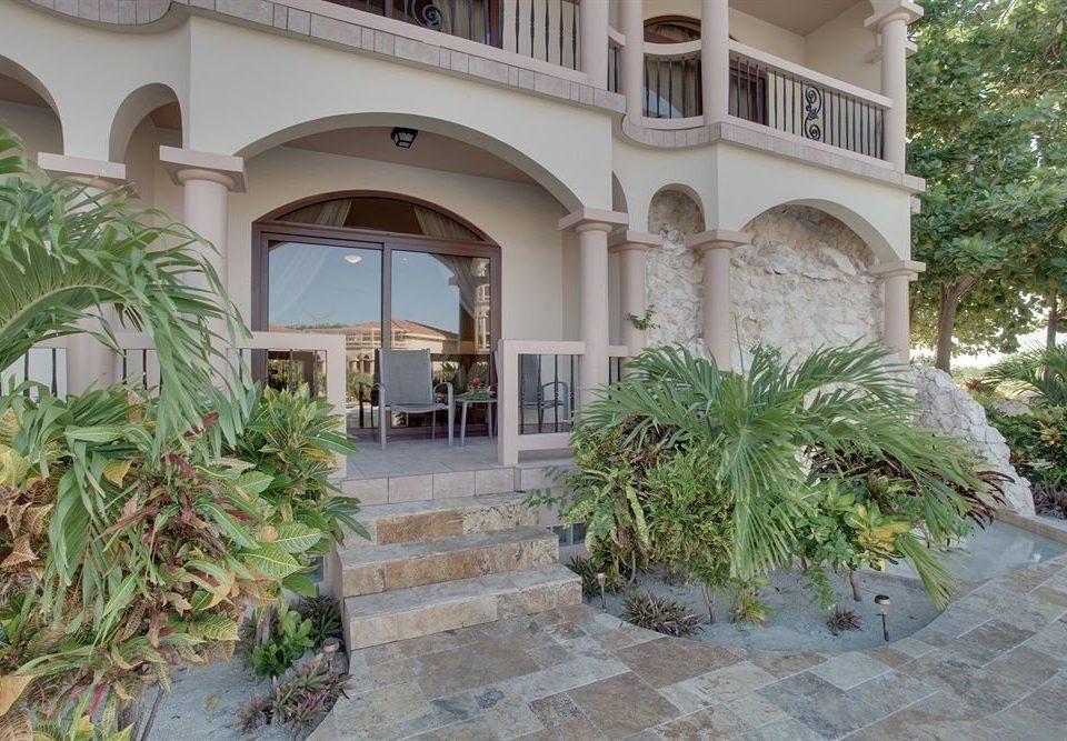 plant property building Courtyard stone home Villa mansion hacienda Garden palace condominium Resort bushes