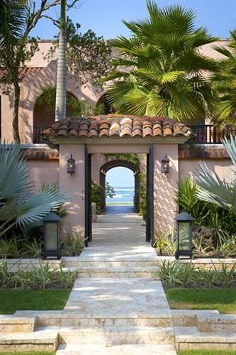 grass tree property Resort Villa hacienda home walkway plant arecales mansion Courtyard park condominium palm cottage Village Garden stone