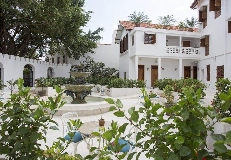 building tree plant property house home Villa Resort Courtyard residential area cottage Garden yard backyard mansion flower hacienda condominium stone
