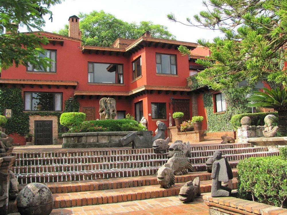 tree building property Resort house home hacienda cottage Villa condominium Courtyard Village stone Garden
