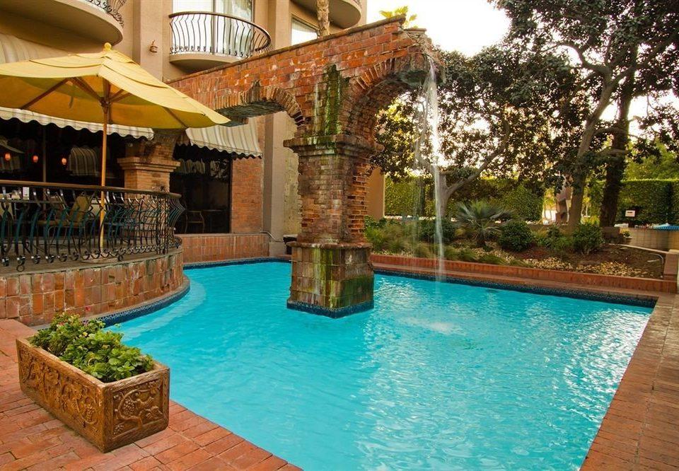 tree swimming pool property building Villa Resort backyard hacienda home mansion plant Courtyard condominium Garden