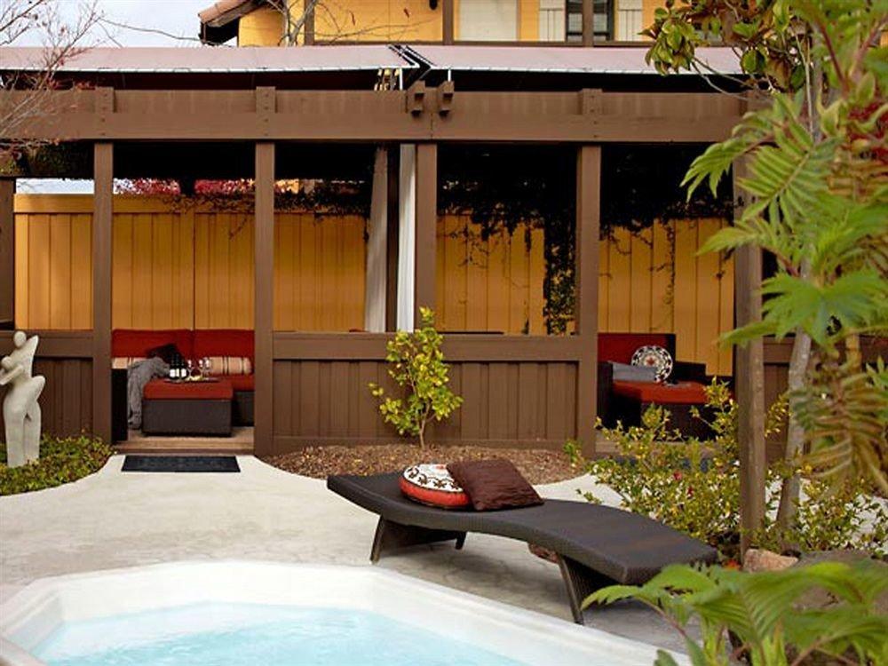 building property swimming pool backyard house home Courtyard Resort Villa outdoor structure hacienda cottage yard mansion Garden plant