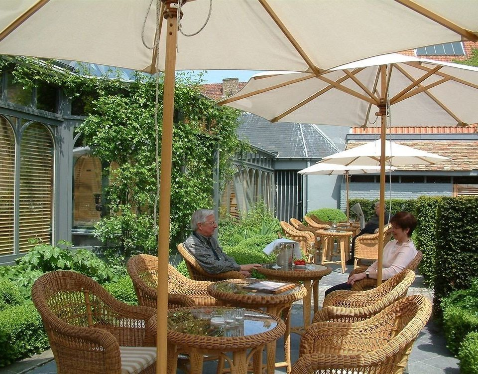 chair property backyard outdoor structure yard pergola Resort Garden cottage Courtyard Villa