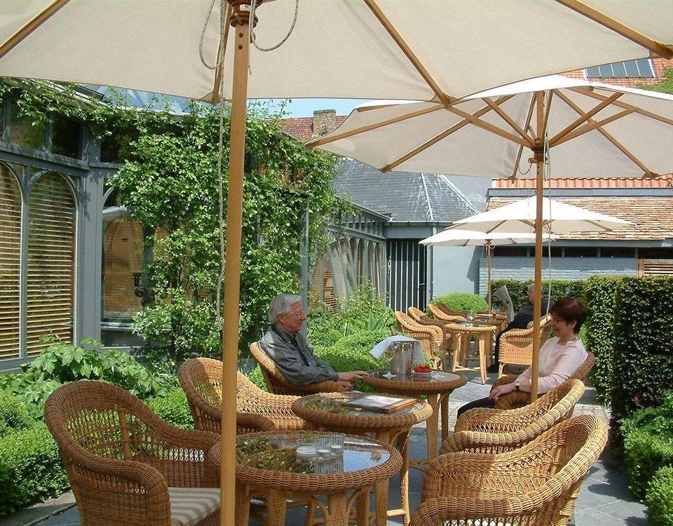 chair property backyard outdoor structure yard pergola Resort Garden cottage Courtyard Villa