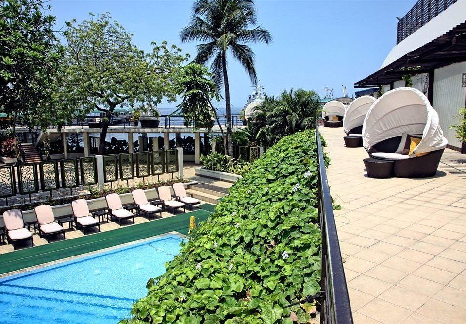 tree sky ground leisure Resort swimming pool Garden Villa Courtyard