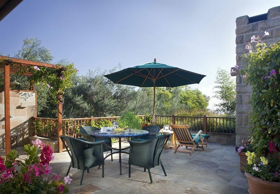 tree umbrella chair property Resort lawn backyard Villa cottage flower Garden Courtyard hacienda restaurant outdoor structure shade day