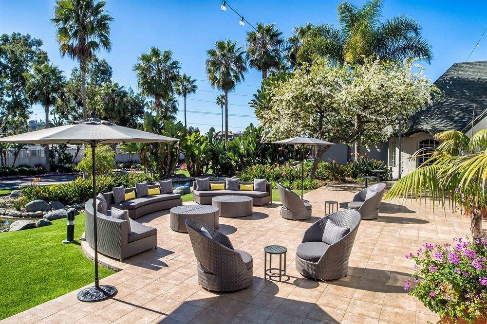 tree sky ground property leisure Resort Villa swimming pool home condominium park plaza backyard Courtyard cottage palm Garden stone lined