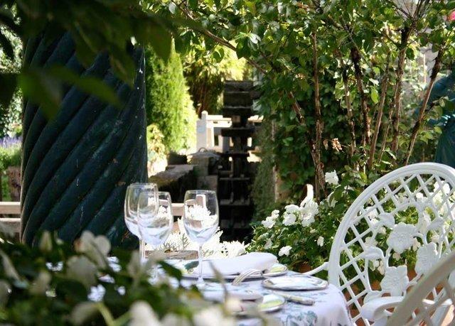 tree flower backyard Garden plant cottage yard outdoor structure Courtyard Resort Villa porch dining table