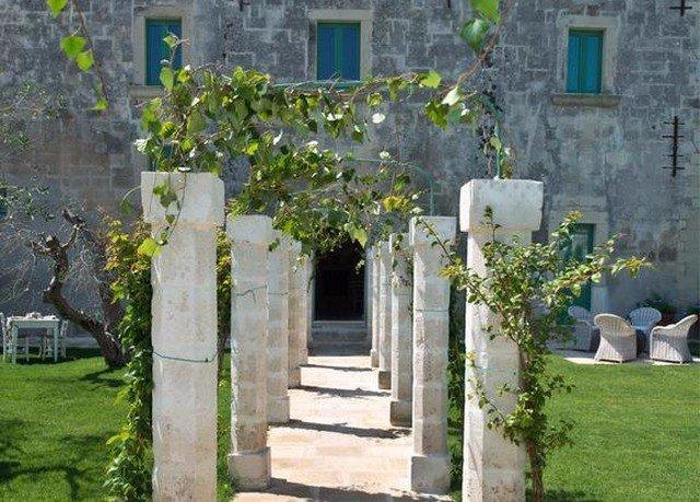 grass building property stone home cottage cemetery hacienda Courtyard mansion arch Village flower Ruins Garden chapel yard Villa cement