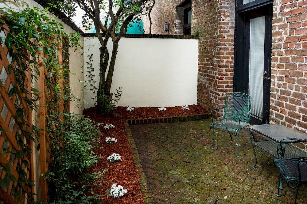 property brick house home backyard yard Courtyard cottage Garden outdoor structure Villa hacienda stone