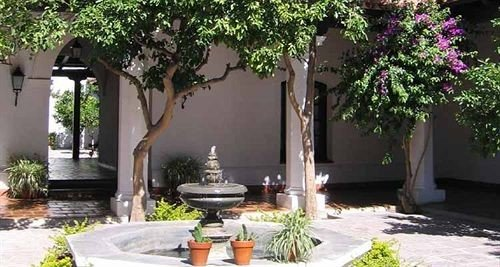 tree property Courtyard plant home Villa cottage yard backyard hacienda Garden flower landscape architect houseplant outdoor structure stone