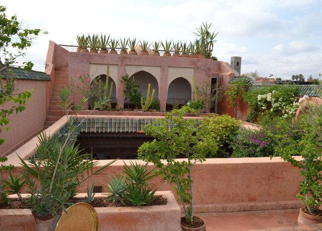 sky plant property building hacienda Villa Courtyard home Garden mansion bushes stone