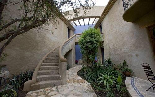 tree property stone Villa Courtyard hacienda cottage home mansion porch plant Garden