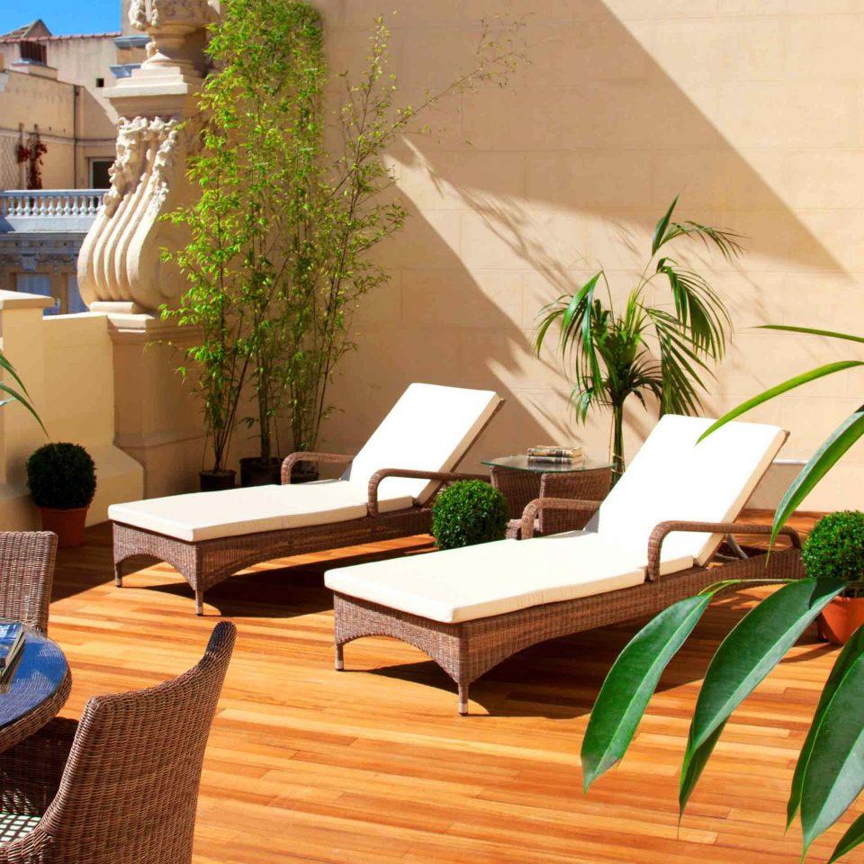 Hip Hotels Lounge Luxury Madrid Pool Spain Trip Ideas plant property condominium home Villa Resort hacienda cottage Courtyard backyard outdoor structure dining table