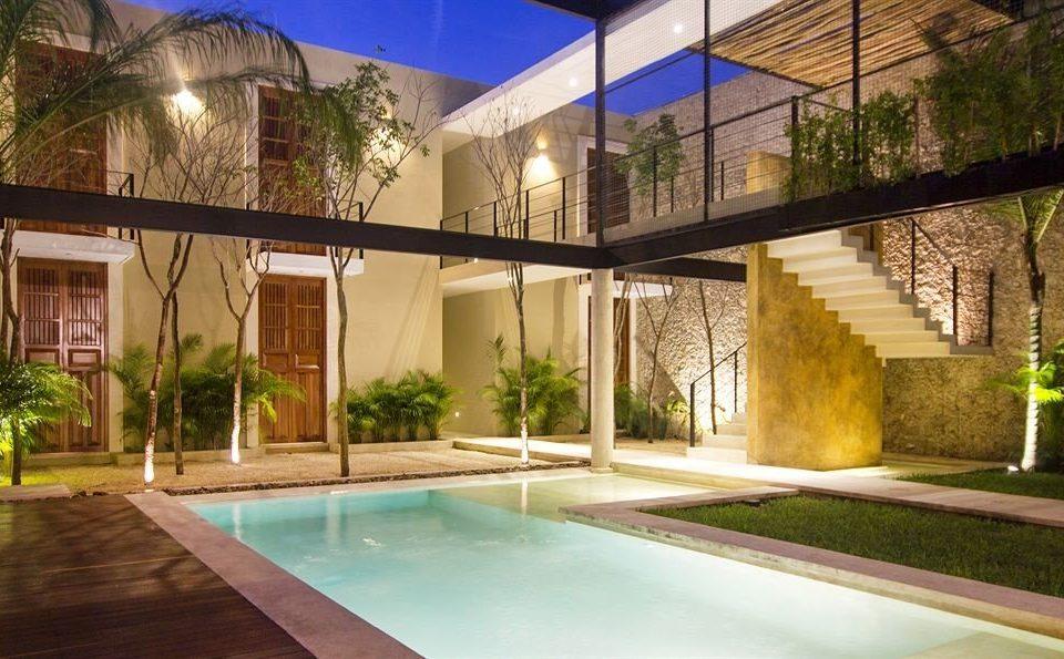 Hip Lounge Luxury property swimming pool building house condominium Villa Courtyard Resort home mansion backyard hacienda eco hotel