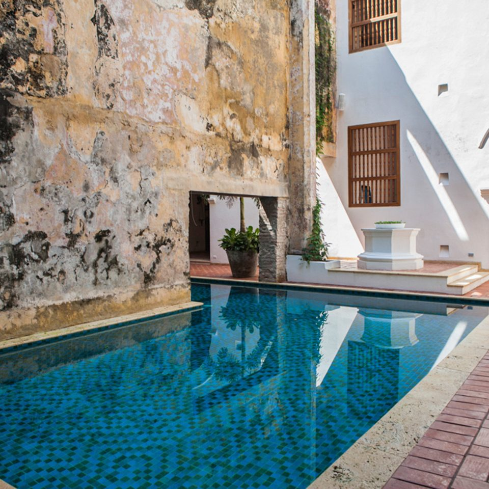 Hotels Luxury Play Pool Resort Romance Solo Travel Trip Ideas building swimming pool property brick stone backyard Villa Courtyard home cottage mansion