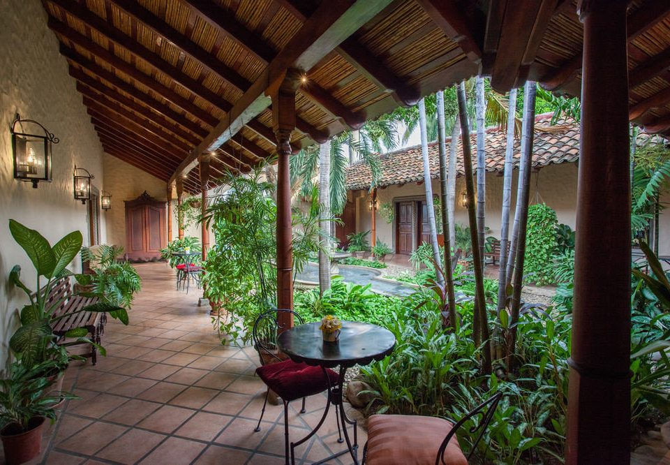 Resort property building porch Jungle eco hotel hacienda Courtyard Villa cottage backyard restaurant plant