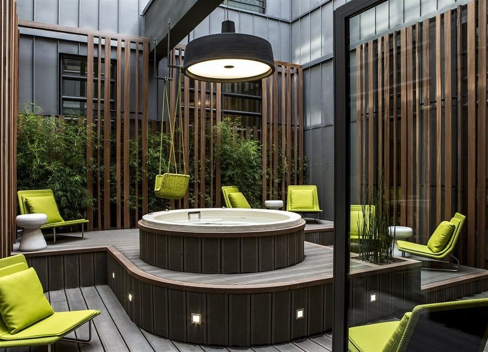 green building home condominium Lobby lighting backyard living room Courtyard porch outdoor structure mansion