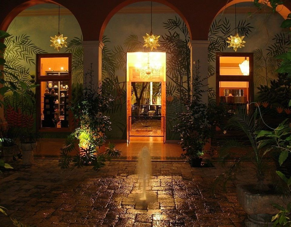fire landscape lighting Courtyard Lobby hacienda lighting mansion