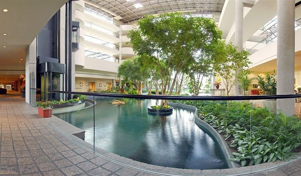 swimming pool building condominium property plaza Courtyard Lobby reflecting pool home Resort porch