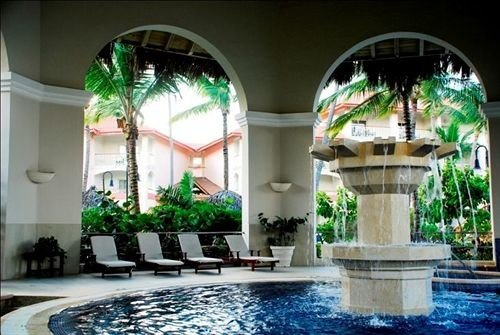 swimming pool property building Lobby mansion green plant condominium water feature Courtyard Resort