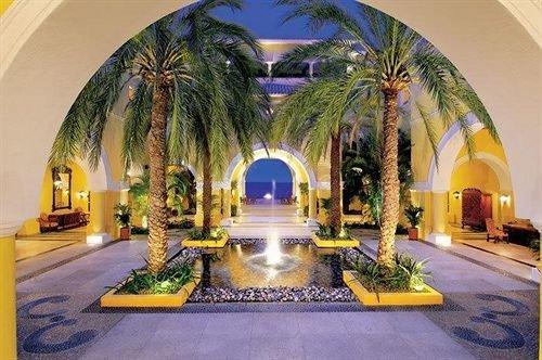 yellow building Lobby hacienda mansion Resort arch palace Villa Courtyard swimming pool altar