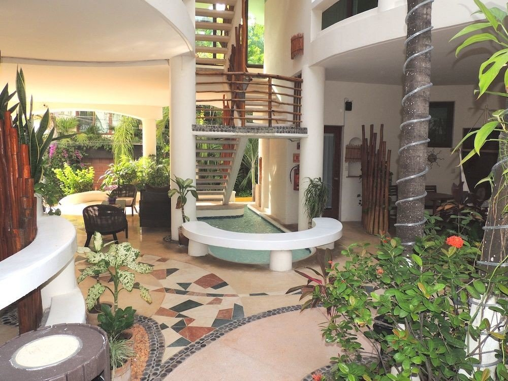 property Courtyard condominium Villa plant backyard Lobby home Resort hacienda mansion outdoor structure cottage swimming pool yard porch
