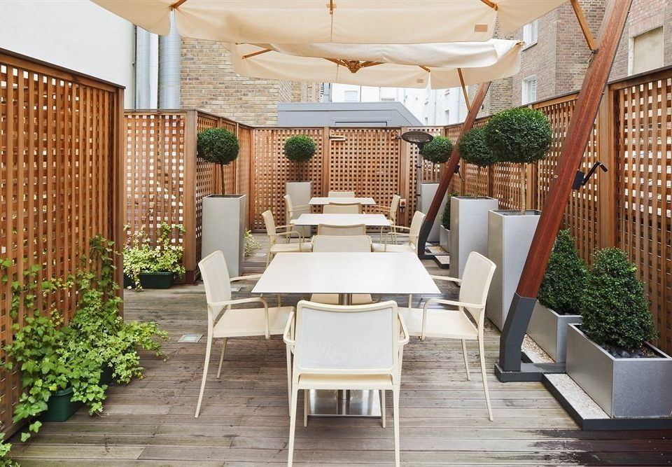 chair property Lobby Courtyard home Resort outdoor structure condominium Villa porch