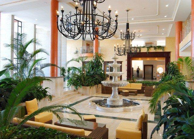plant property Lobby Resort condominium home floristry restaurant Courtyard Villa hacienda dining table