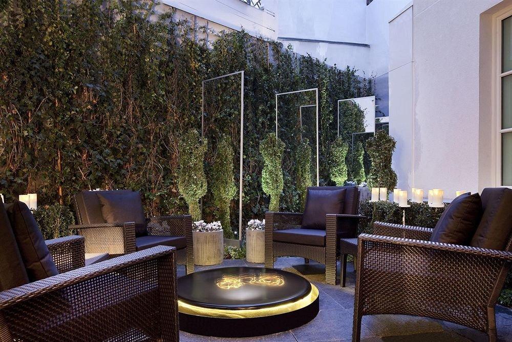 tree chair property home Lobby Courtyard condominium backyard living room Villa outdoor structure