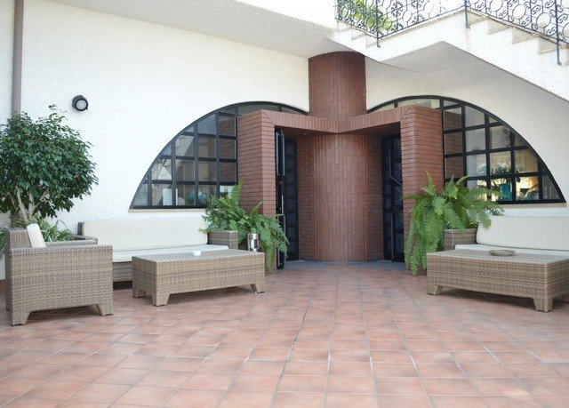 ground property Lobby building Courtyard hacienda Villa brick outdoor structure home condominium stone flooring tile mansion tiled cement walkway